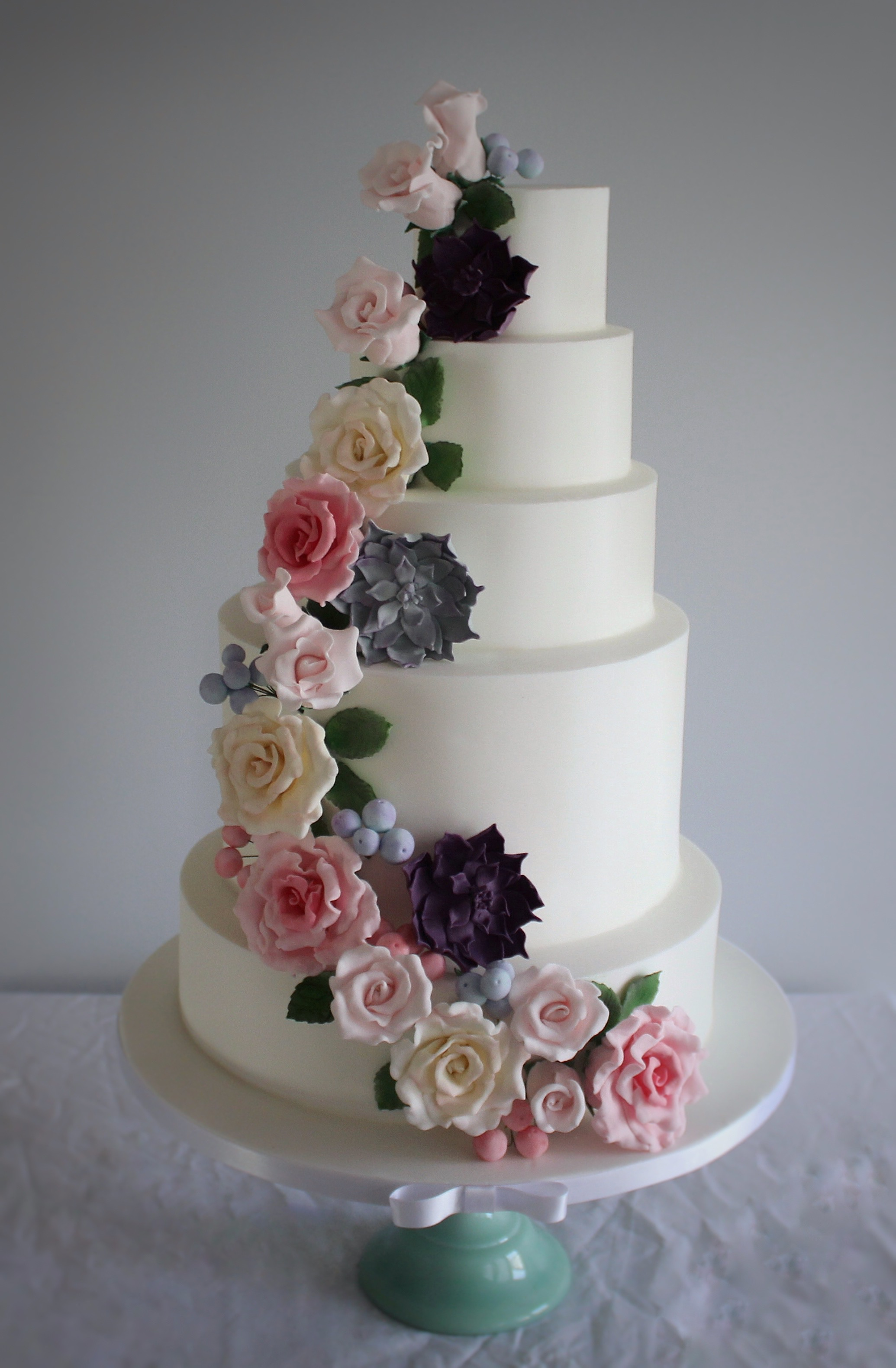 6 Tier Wedding Cake With A Cascade Of Pastel Sugar Roses Succulents And Berries Luxury